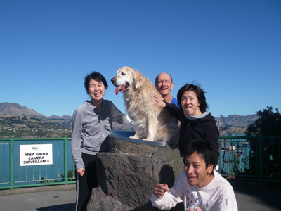 Japanese guests with dog at Lyttleton Harbour