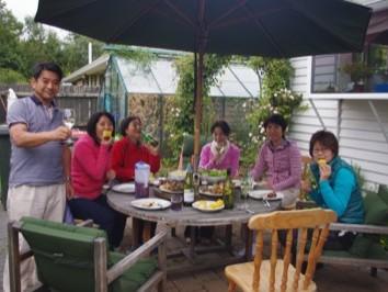 Guests enjoying BBQ dinner in the garden